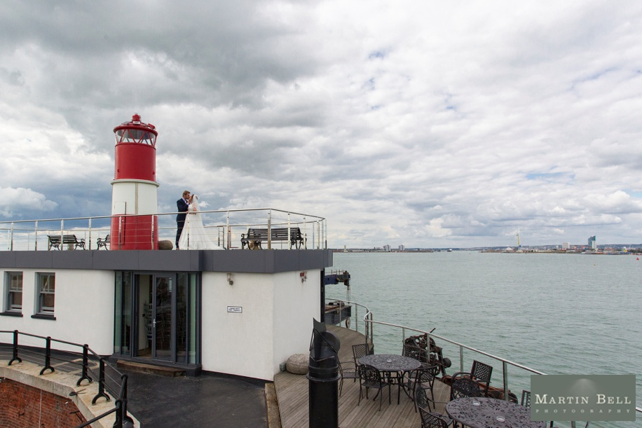 Spitbank Fort wedding photography - Bride and Groom by the lighthouse on top of the Crows nest - Martin Bell Photography