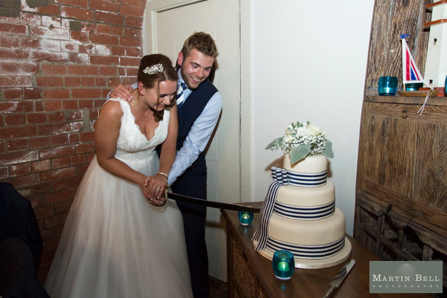 Cutting the wedding cake at Spitbank Fort