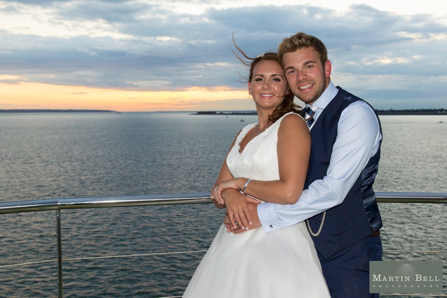 Bride and Groom during a sunset at their Spitbank Fort wedding