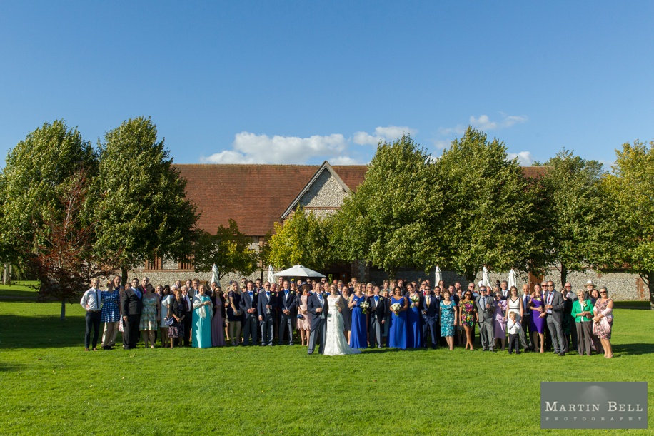 Big group photo at a Tithe Barn wedding
