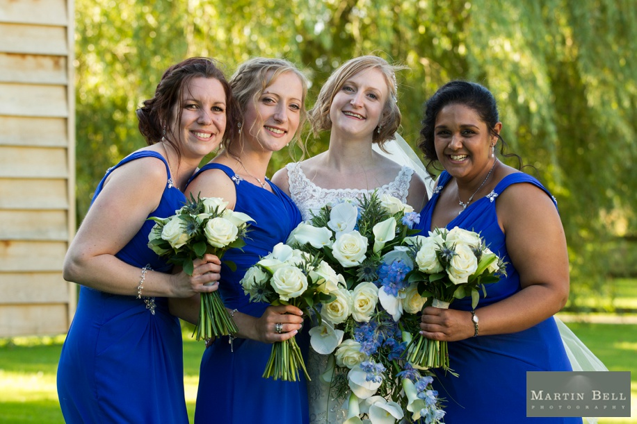Bride with her Bridesmaids at Tithe Barn in Hampshire on her wedding day