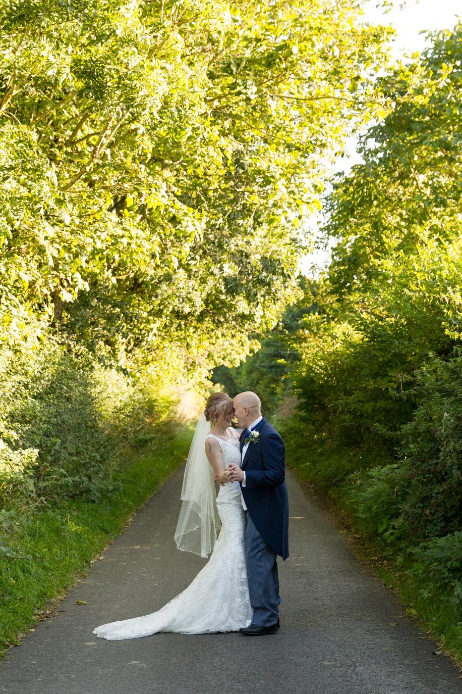 Tithe Barn wedding photography of the bride and groom