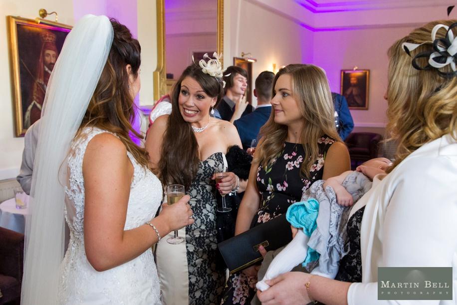 Documentary wedding photography at Rhinefield House wedding - Drinks reception