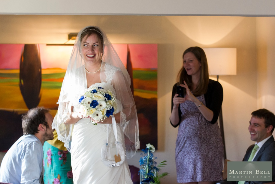 Fun wedding photographs during reception drinks at Rhinefield House