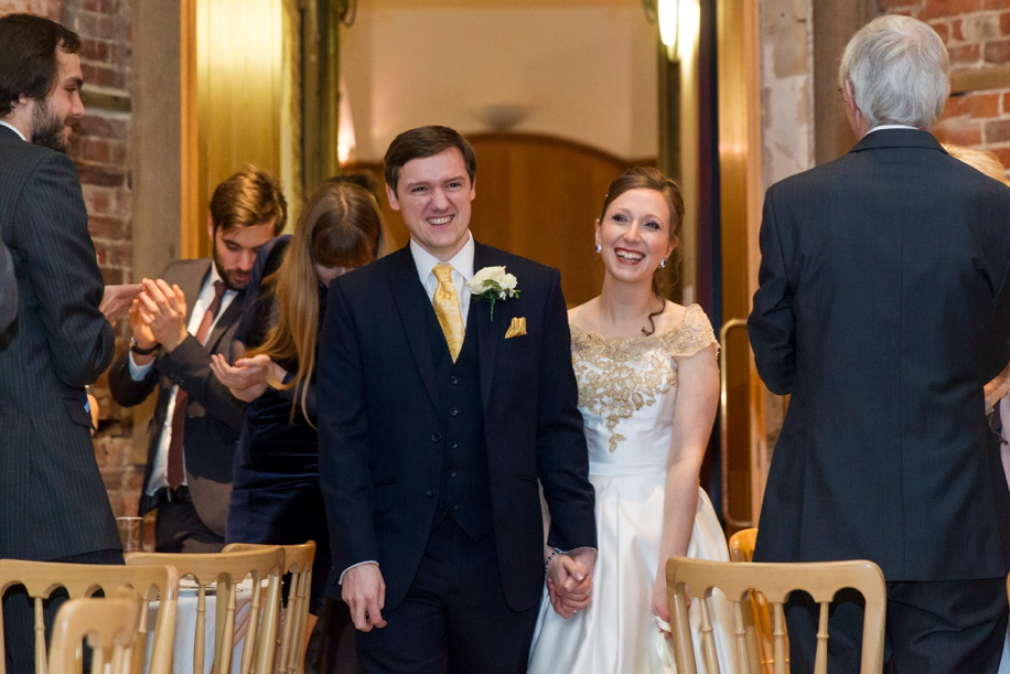 A very happy Bride and Groom going into their wedding breakfast at Highcliffe Castle