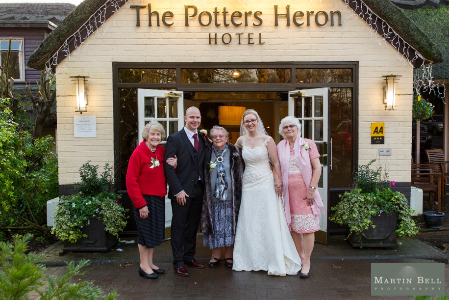 family photographs at a potters heron wedding - Bride and Groom with their grandparents